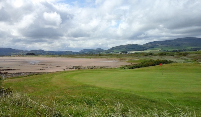 Scenic But Sinister -- Don't let Southerness' benign looks fool you. The 12th hole, pictured here, serves as an object lesson. Lovely views. But those white OB markers lurk just behind the putting surface.