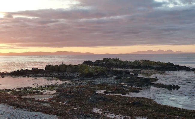 In the Isle of the Calm -- Here's the view from our holiday home in Machrihanish. The islands along the horizon are Islay (left) and Jura (right).