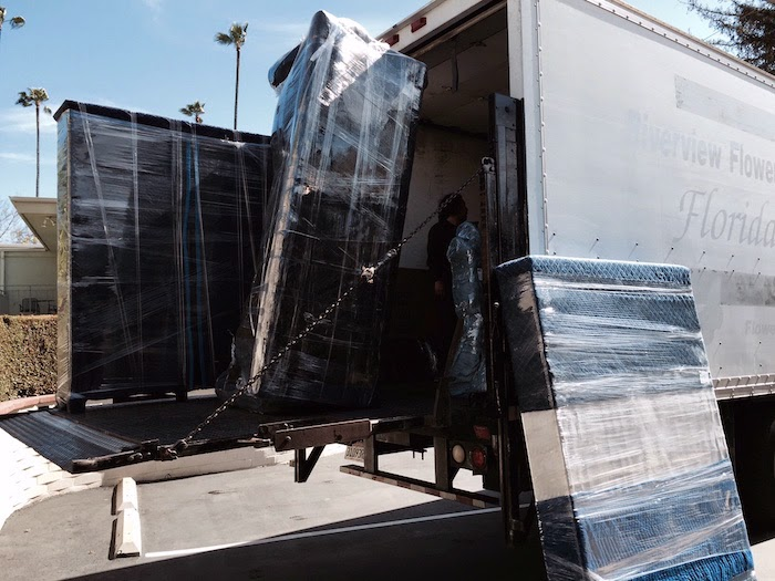 Heavy Lifting -- I did most of the packing. But I left it up to the professionals to do the heavy lifting. This load is destined for Dallas. The first wave, loaded last Thursday, is bound for Scotland.