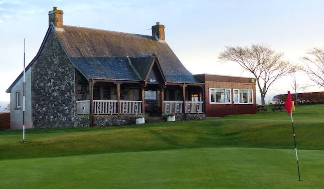 Happy Ending -- Spoiler alert: The weather improved by the time I arrived at the 18th green. The number above the entry way to the clubhouse is 1894, the year the club was founded.
