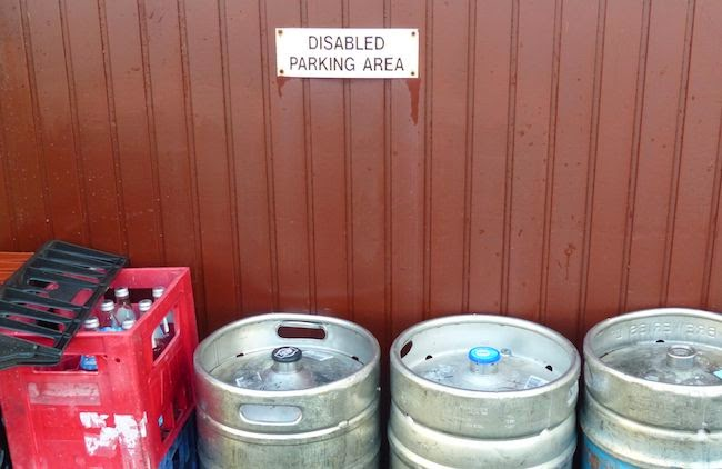 Self-inflicted Wounds -- Just couldn't resist snapping this shot along the back wall of the Jedburgh clubhouse. Those silver cylinders are beer kegs.