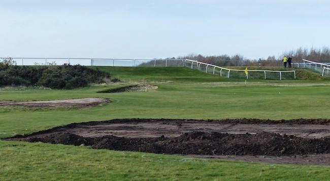 Bunker Mentality -- Here are two of at least a dozen bunkers being removed by order of the East Lothian Council, the Musselburgh governing body that oversees the publicly-owned property. The alteration of the world's oldest golf course, apparently in an effort to save money, has engendered something less than unanimous approval among the historically minded.