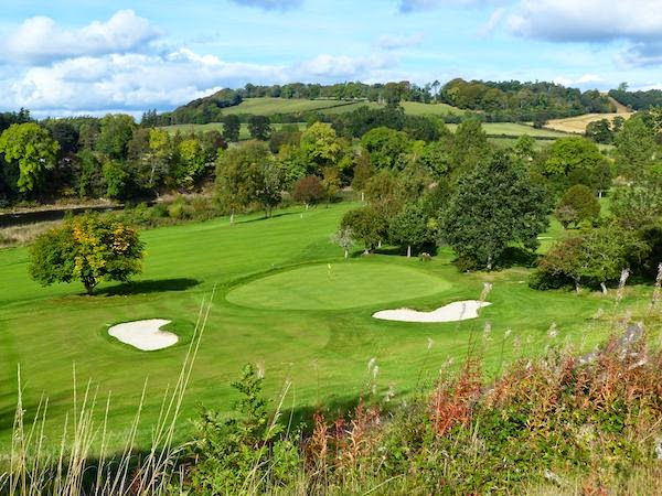 Picture Postcard -- The 2nd hole, a downhill par 3, sets the stage for the   bucolic   scenery   to follow. A portion of the River Tweed is visible in the   middle left of   this photo.