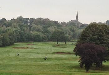 Steeple Chase -- St. Michael's serves as the backdrop for Musselburgh   Golf Club's opening hole.