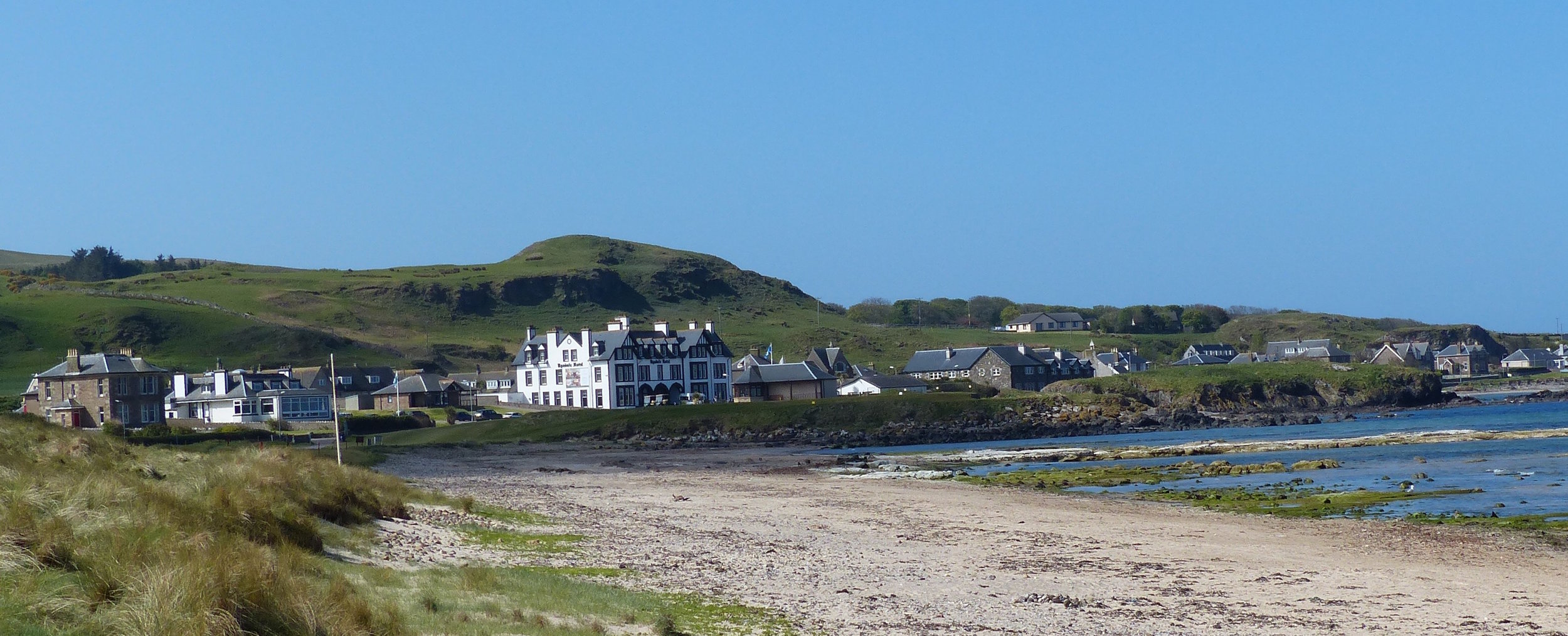 Fresh Perspective --  Here's a view looking back toward the first tee at Machrihanish. The prominent building near the center of the frame is the thoroughly restored version of the Ugadale Hotel whose origins date back to Victorian times.