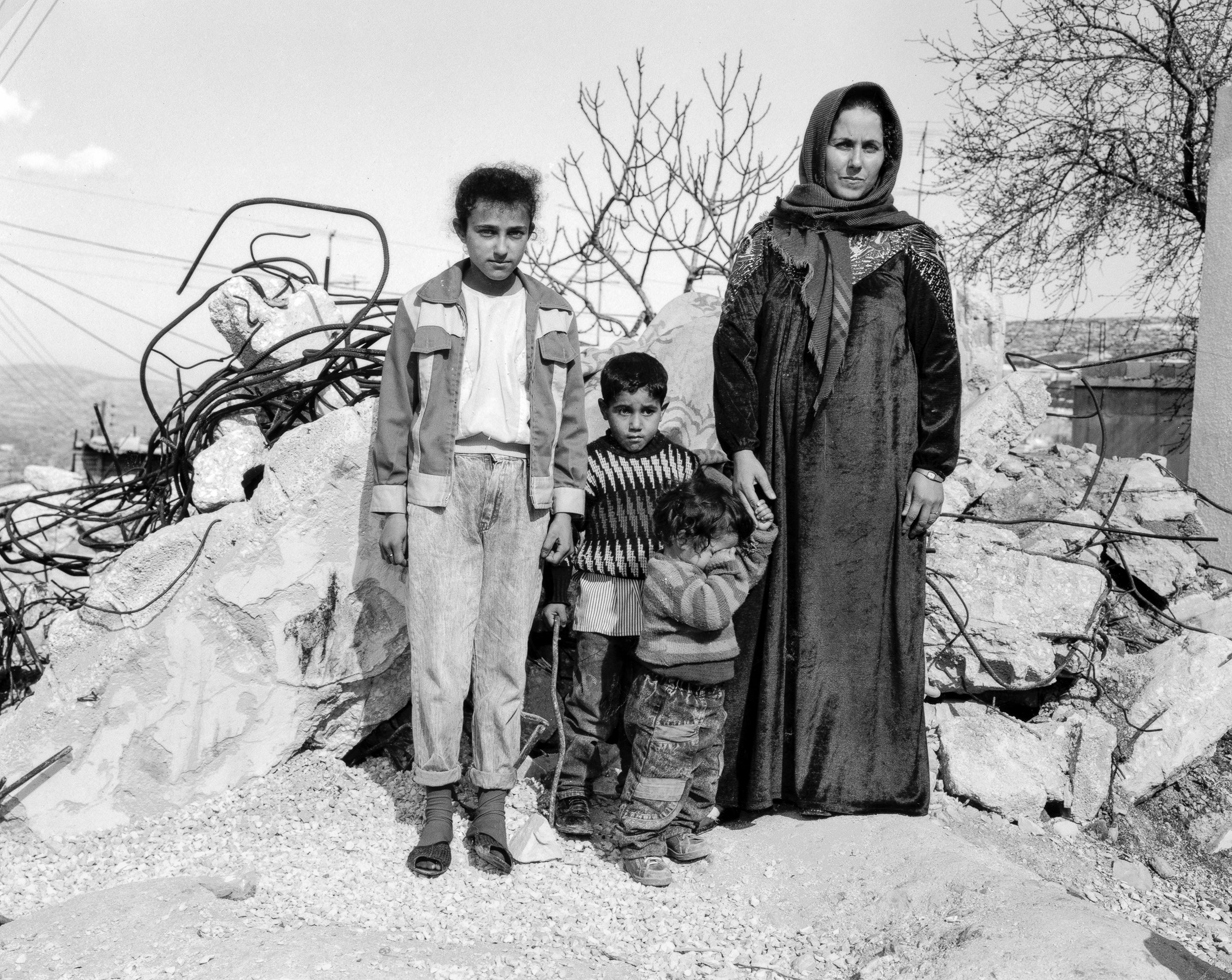 Hally Pancer_some arans and some jews_Palestinian family outside their demolished house_09.jpg