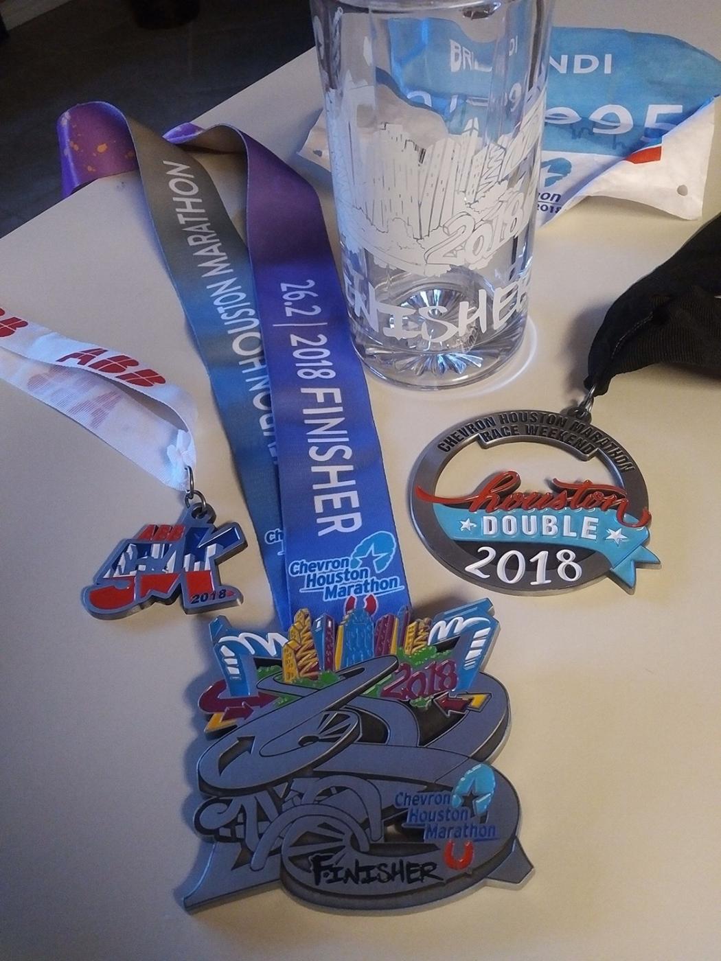 ABB 5K medal, Marathon medal, and Houston Double medal for running them both.
