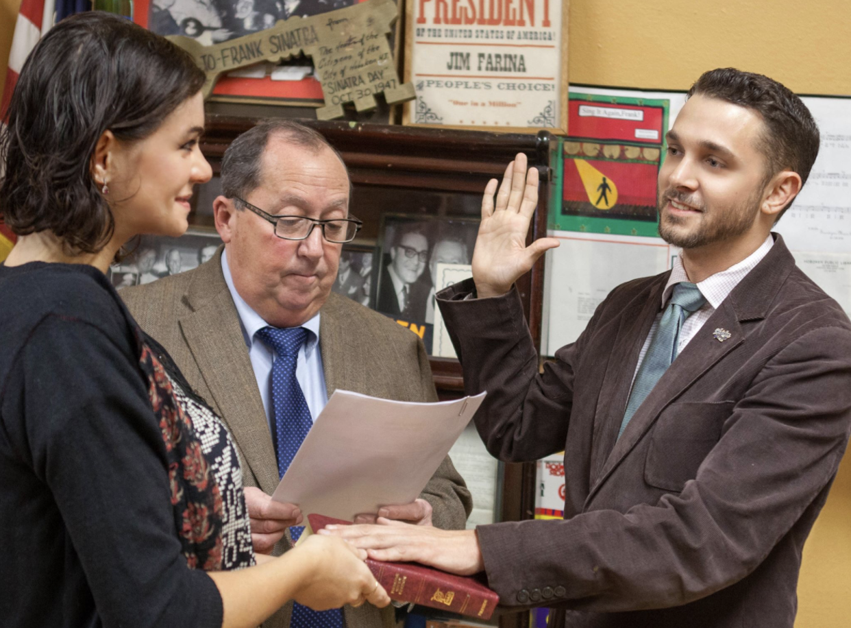 Mike being sworn in to his second term as a Commissioner on the Zoning Board by City Clerk James Farina.