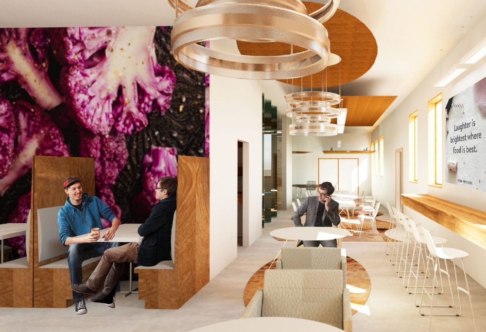 THE plated office breakout space offering a variety of seating options, strong daylight from the accessible terrace windows, and a feature graphic wall.