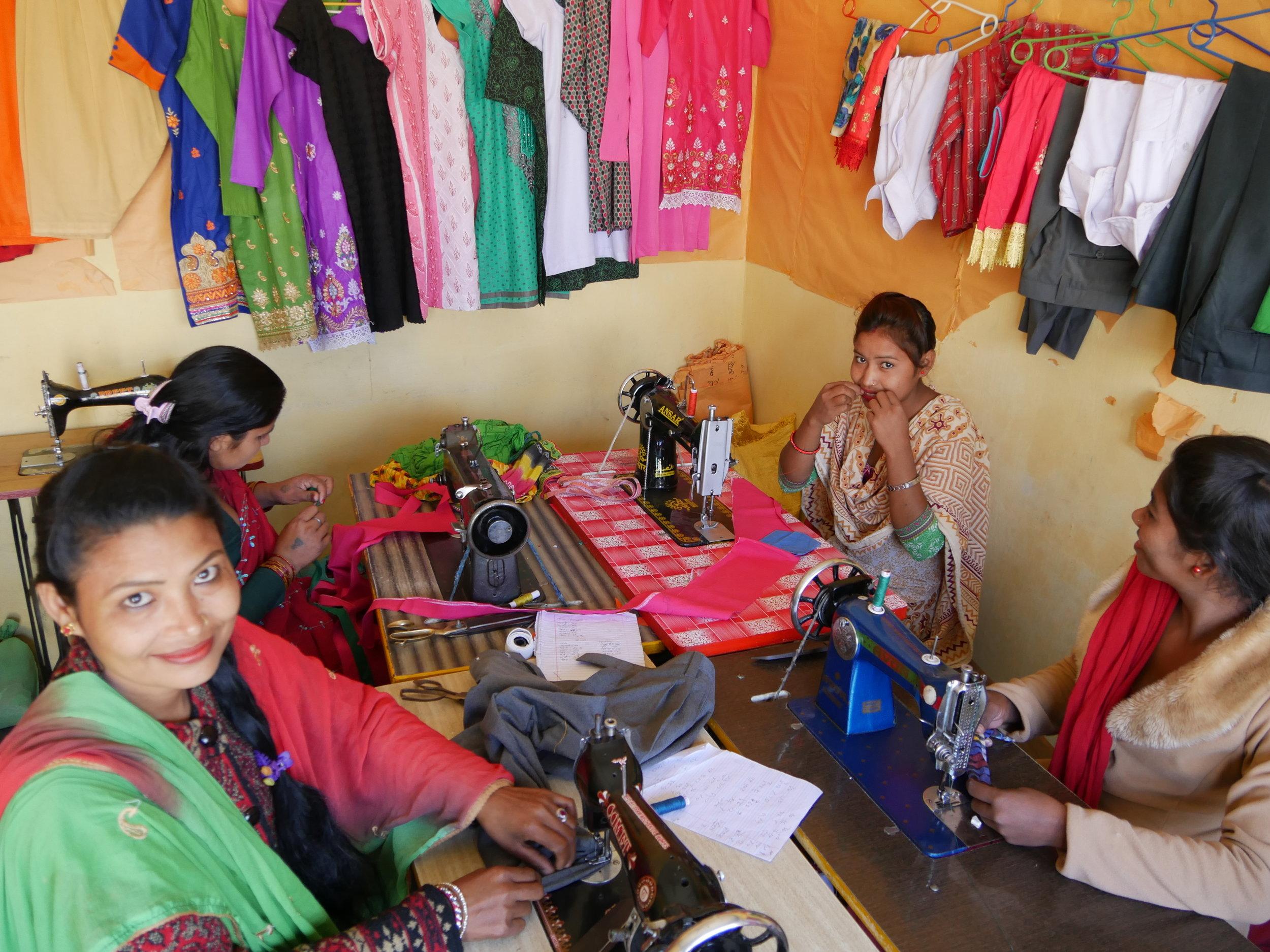 Hari Kumari's and her students hard at work making beautiful and colourful clothing