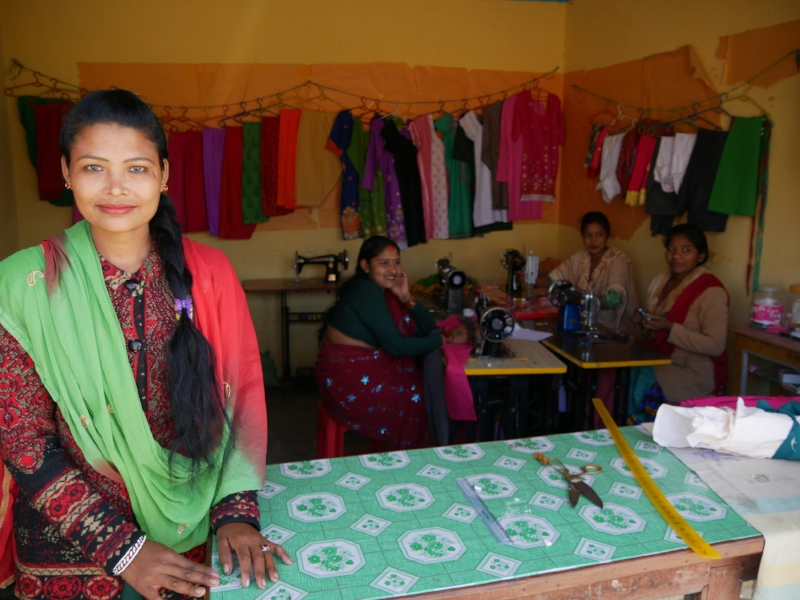 Hari Kumari standing proudly at the front of her shop