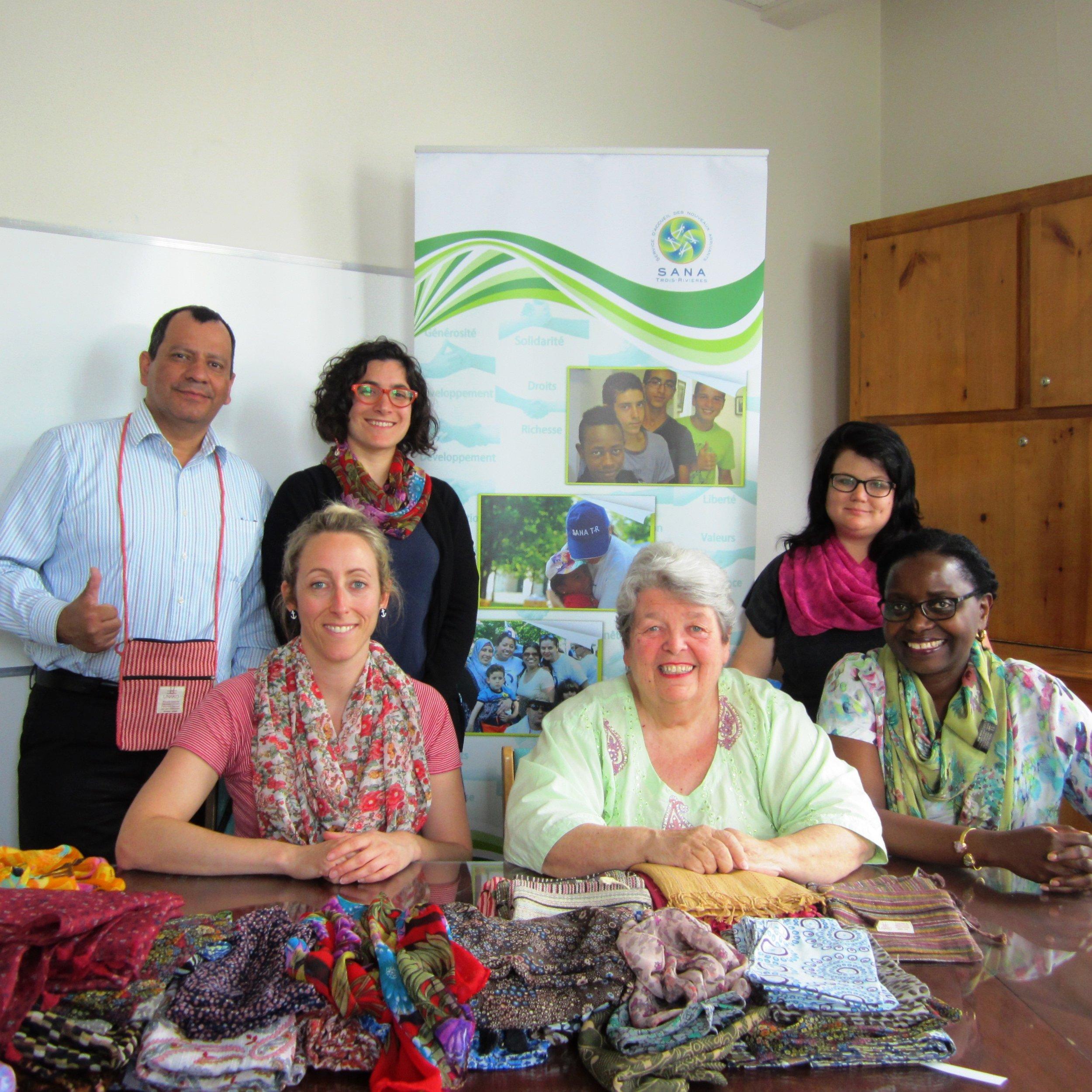 Her International founder, Michelle Bonneau (centre), with SANA Director, Ivan Souaza, and SANA staff