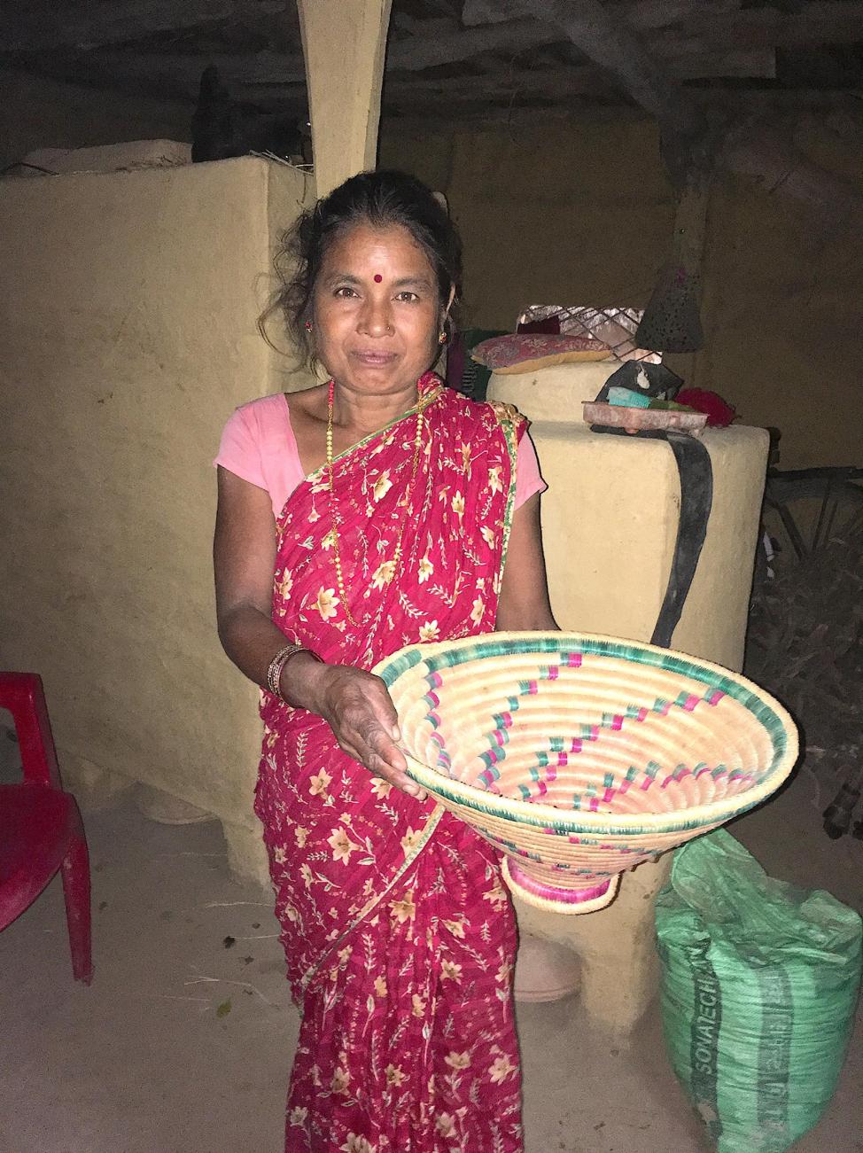 Dhankumari with her hand woven basket