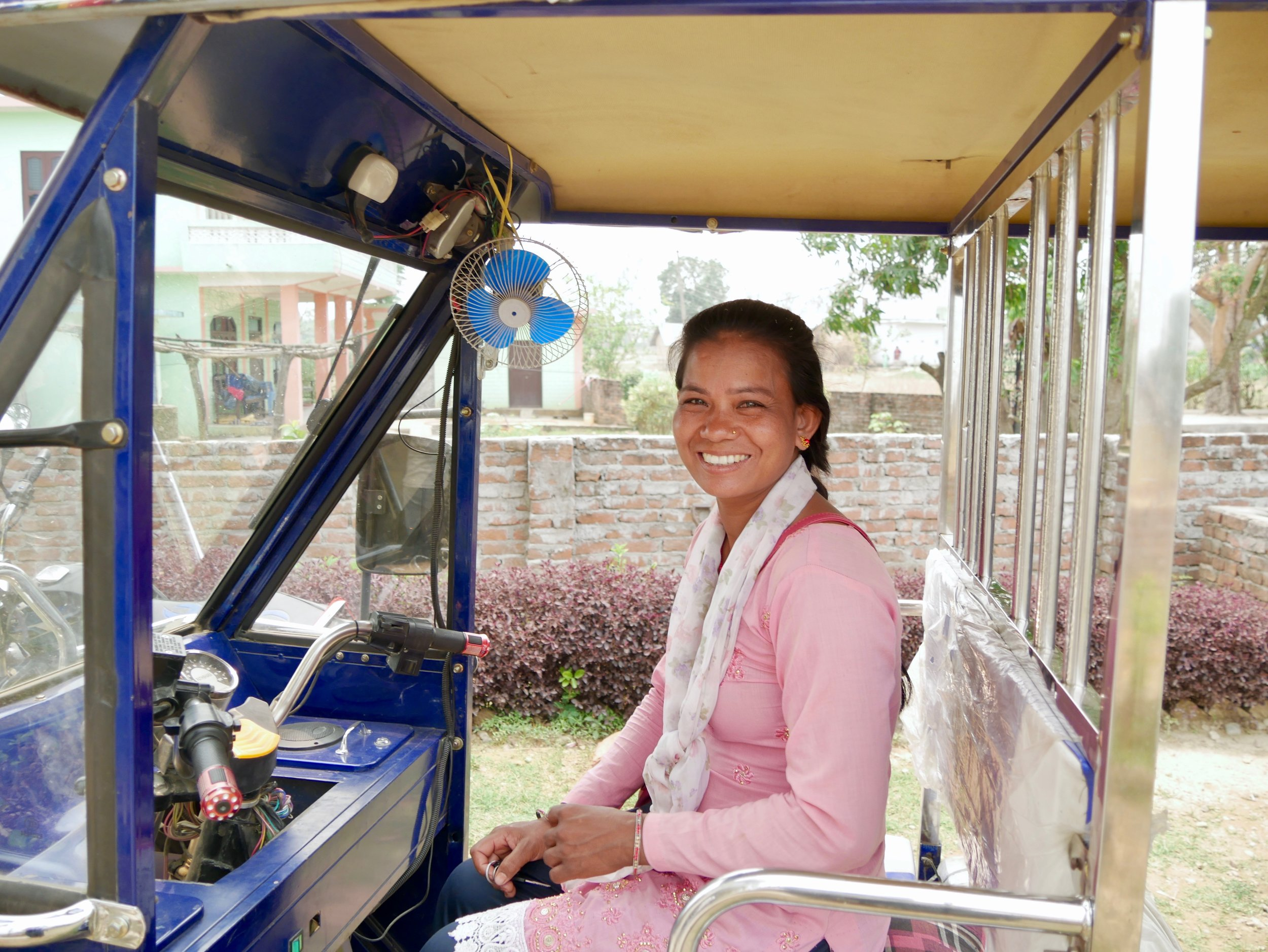 Pharma took a loan from her group to become the first female auto rickshaw driver in the area.