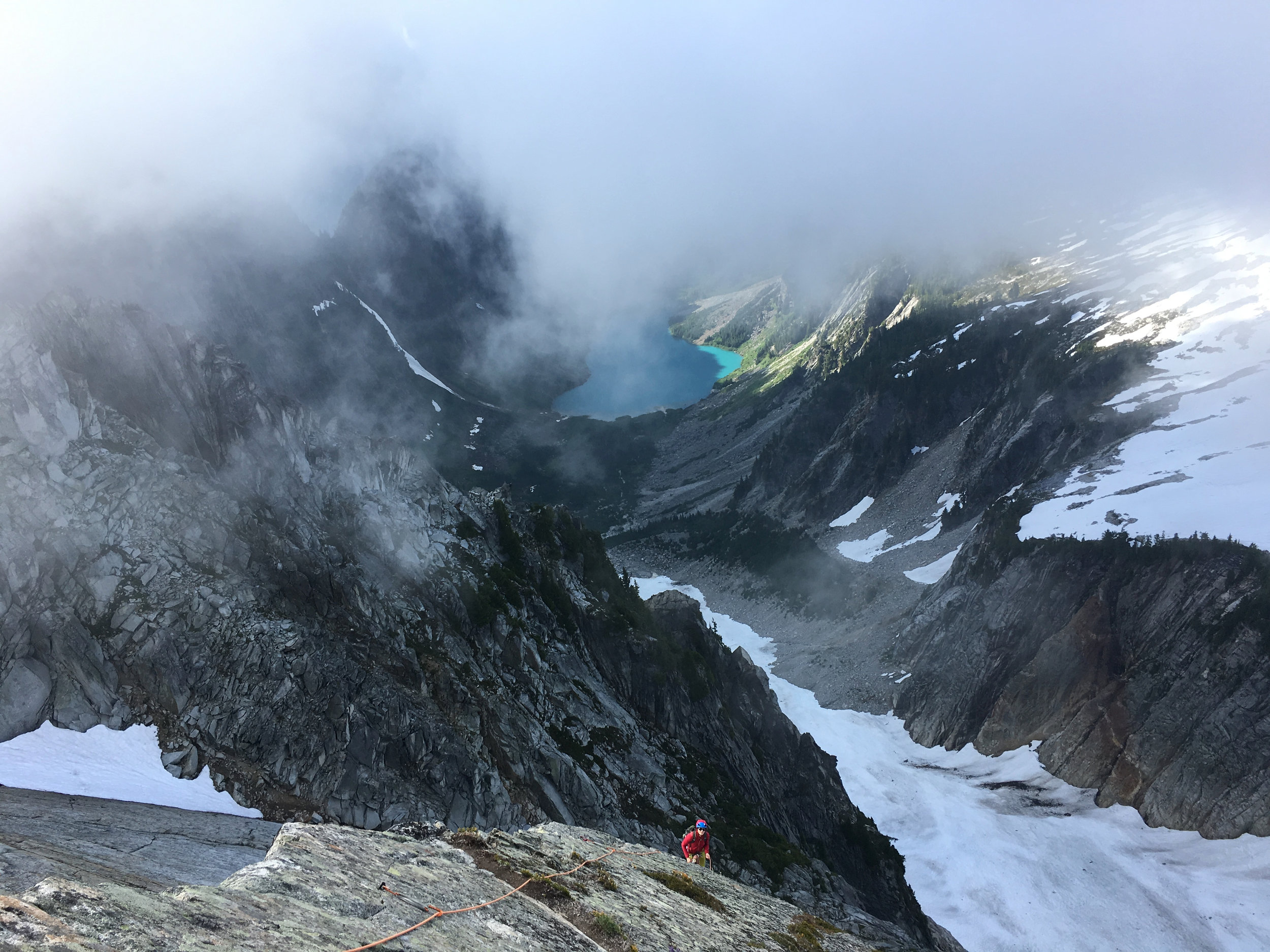 Looking down at the final belay as the clouds closed in on us again