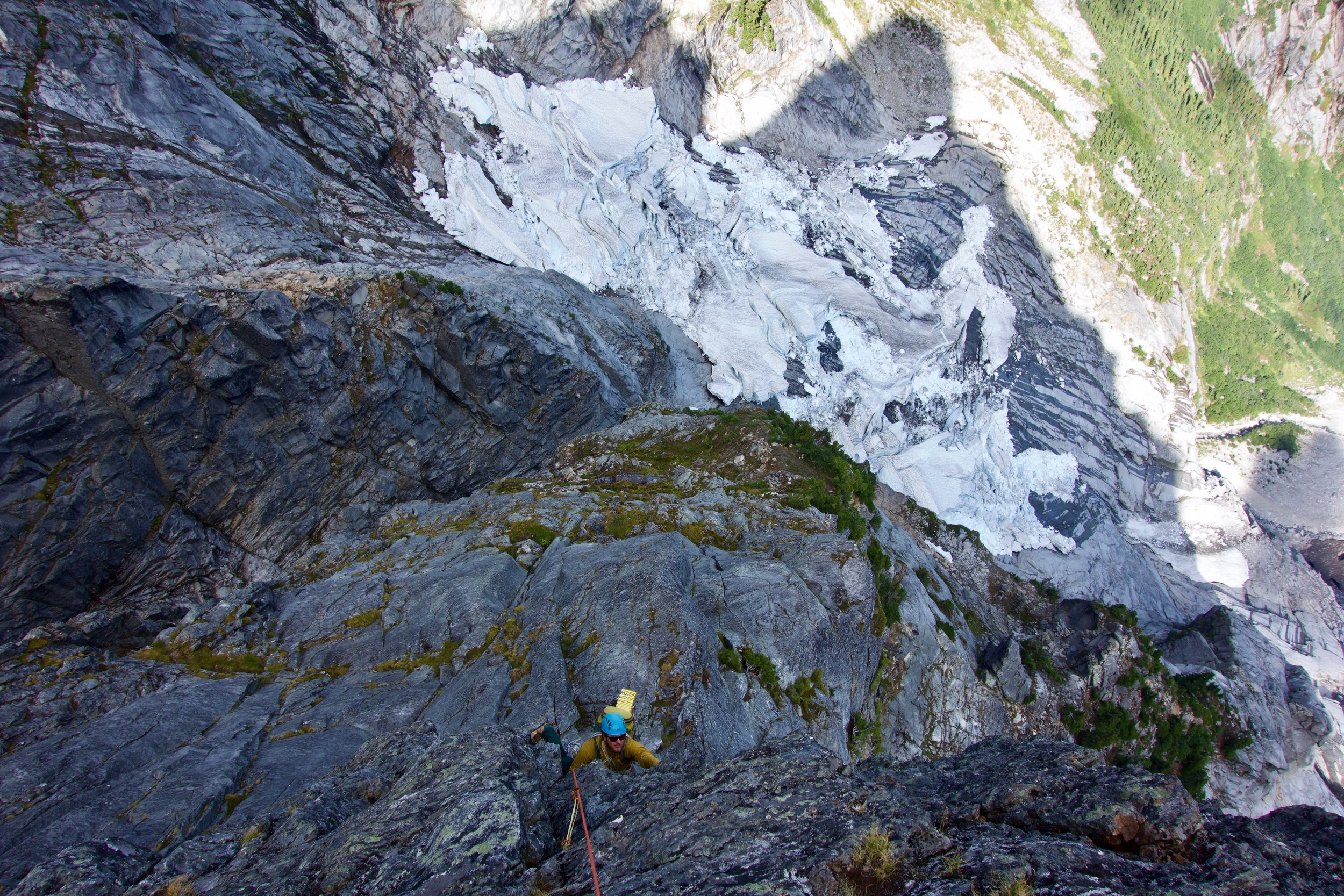 Adam, following the crux roof pitch with the summit's shadow behind