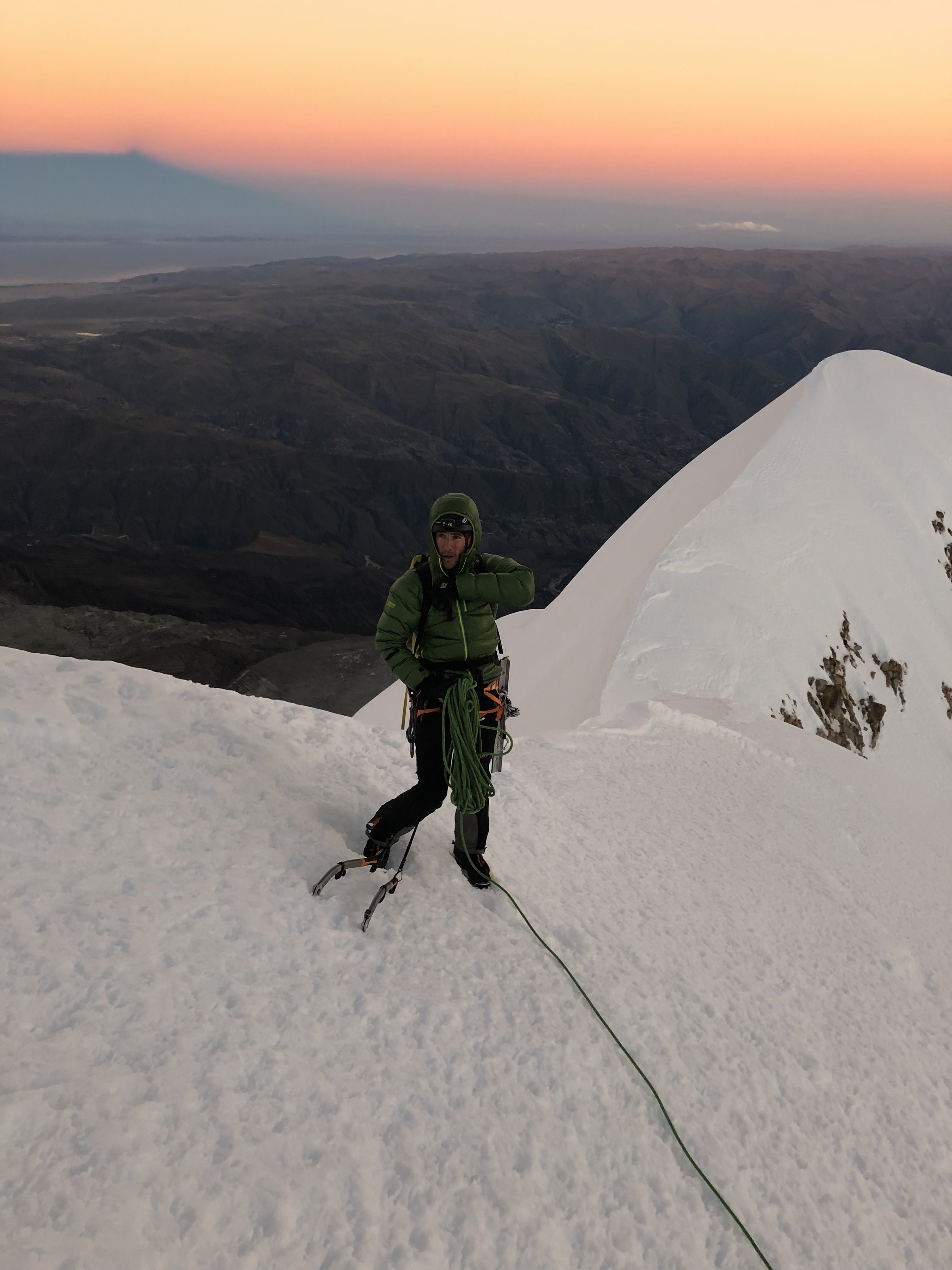 On top of the headwall with the summit shadow behind