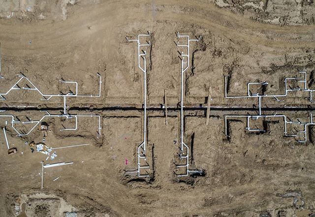 Symmetrical pipes being installed for an apartment complex. . . . #dronephotography #drone #djiglobal #fromwhereidrone #drone_countries #explorecreate #beautifulplaces #droneofficial #skypixel #skyhilife_drones #gameofdronez #dronedose #dronespace #dronedaily #iamdji #droneart #thedroneu #droneglobe #dronenerds #majestic_earth #mastershots #beautifuldestinations #electic_shotz #earthpix #dronepals #agameoftones #ohio #wanderlust #construction #underground