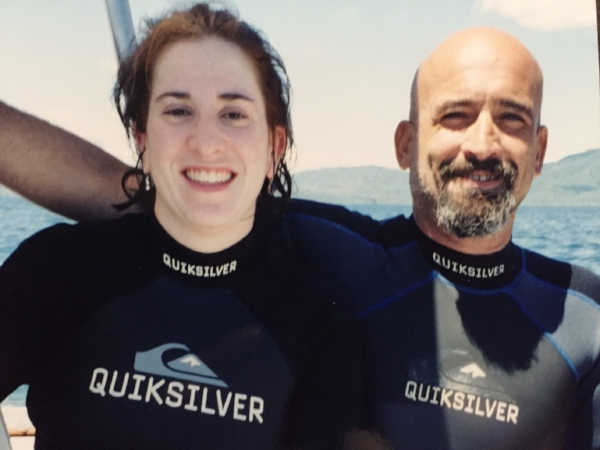 On the boat with my dive master. I was such a wimp I held this poor guy's hand the entire dive.We swam by a bunch of sharks, maybe 20 yards away? And saw GORGEOUS fish.