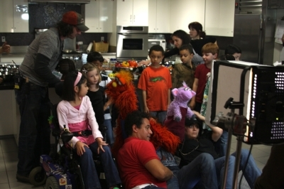 Behind the scenes, the kids watch the puppeteers position themselves. Murray required TWO people. Two hands for one arm and head and then another person for the second arm.