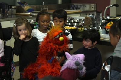 My little student is so happy to talk to the puppets.