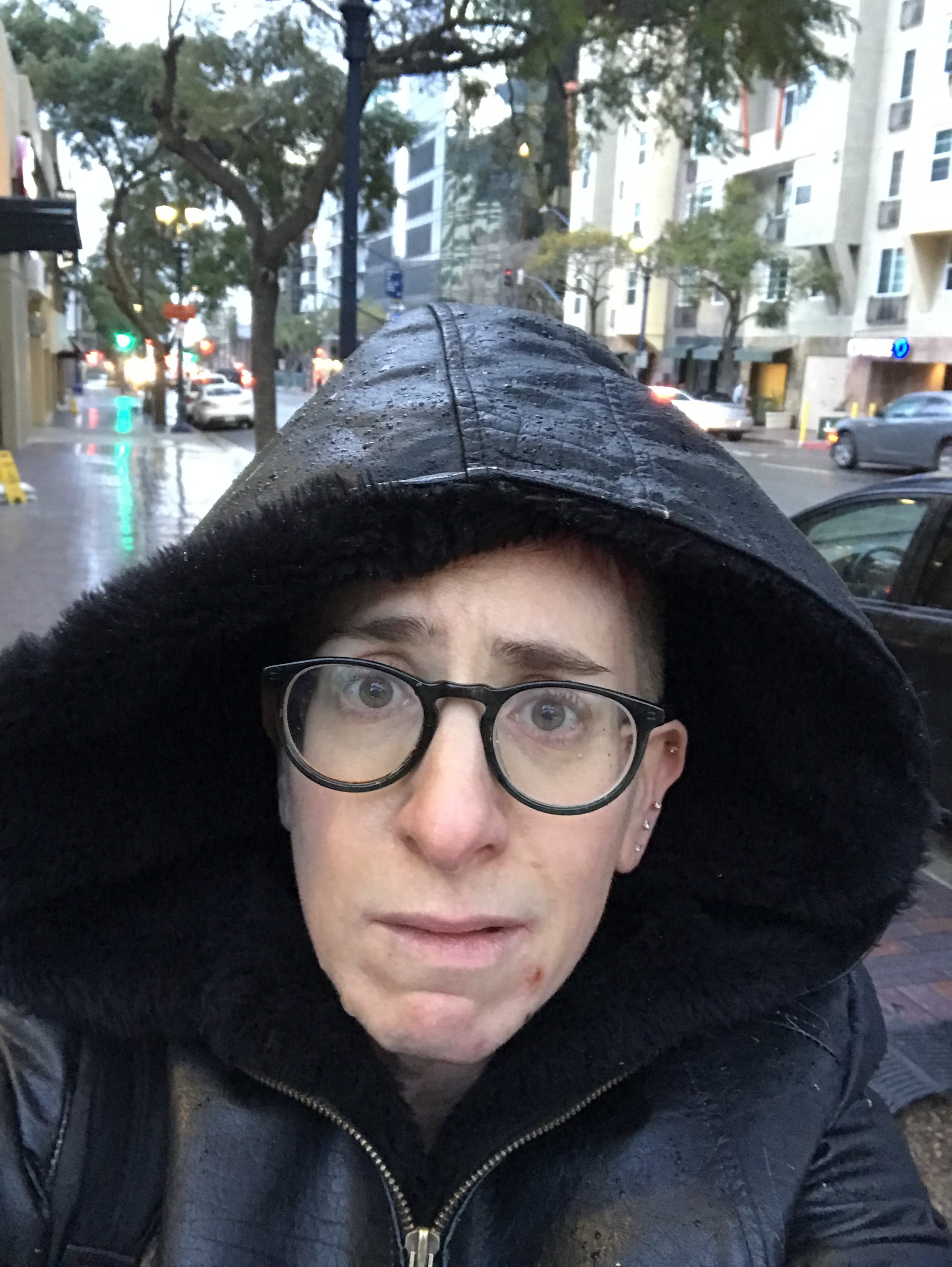 This is me walking in San Diego WHERE IT WAS RAINING most of the week. That's right it was hailing and raining in San Diego! Thanks Universe!! I just wanted some light, man….
