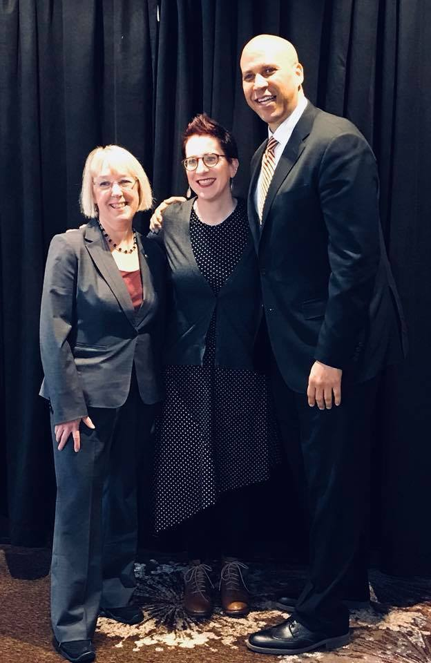 I've also done a bunch of activist work to protect healthcare! Because of my work, Senator Murray gave me her golden tennis shoe award in 2018 and cory booker came too!