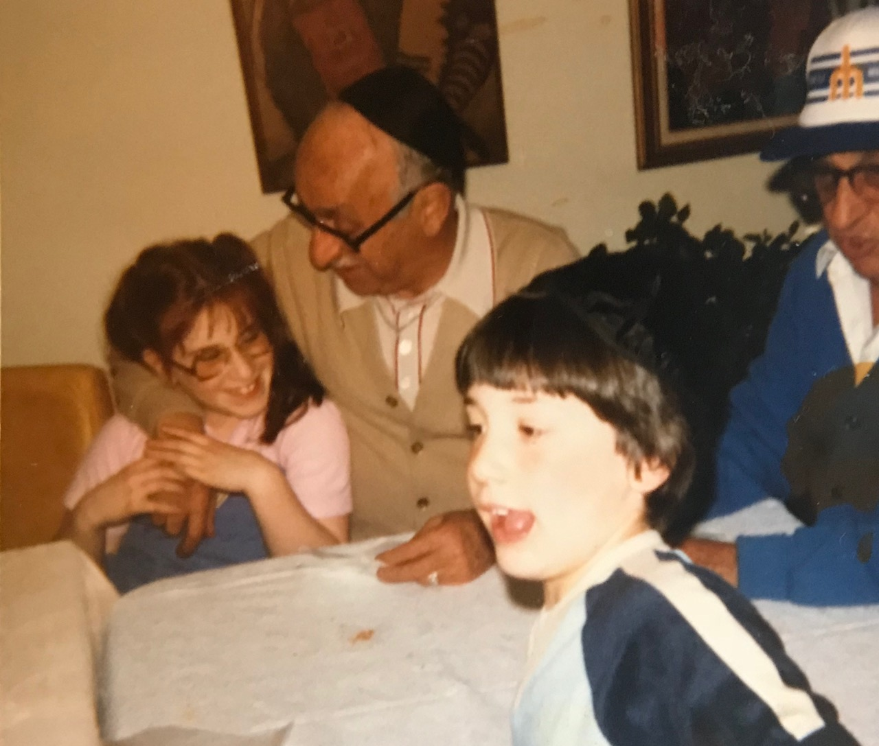 "That's me on the left with the bifocal glasses, my Papu Albert - the cool one that owned the Tacoma pawn shop and was tough as nails - his twin brother, Jack to the far right, he was the coolest too. He volunteered at the Jewish Day school so there is an entire generation of people (my age) that adored him. They put ""Uncle Jack"" on his tombstone! That's my brother in front."