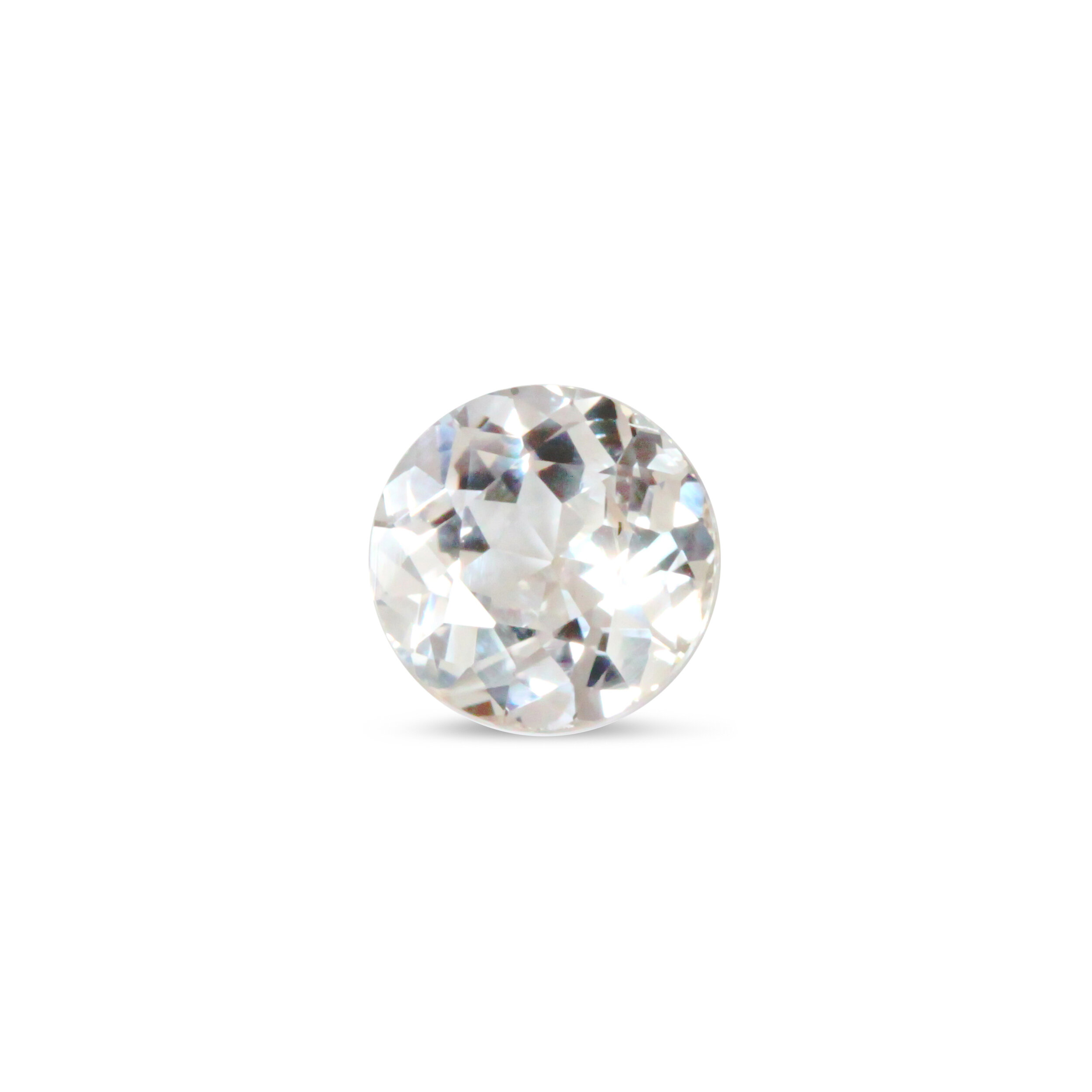 This near-colorless sapphire was diagnosed by AGL (New York) with a rare phenomenon. When the color center is active, it appears pale yellow-orange. When the color center is relaxed, it is near colorless with a slight bluish tinge. A collector was thrilled to acquire this rare gem from us, so an unstable color center is not always a bad thing.