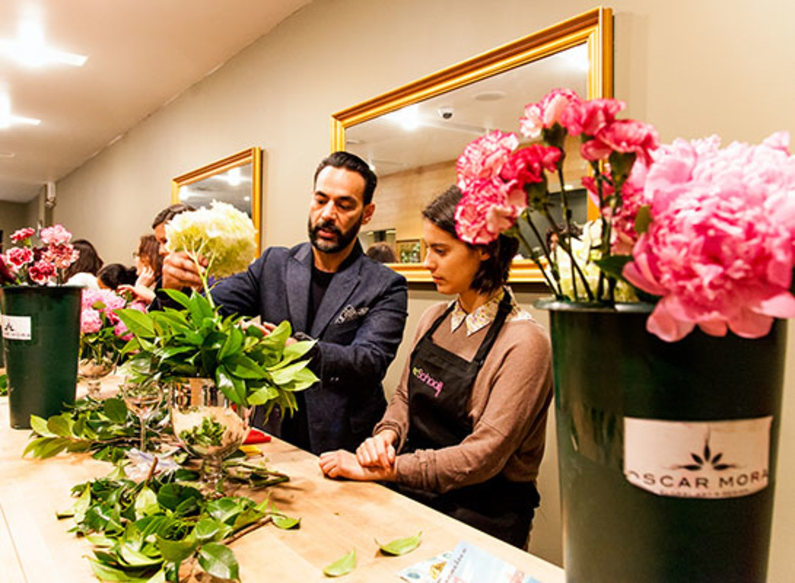 Mora shows AD assistant editor Rebecca Santiago the basics of flower arranging. -