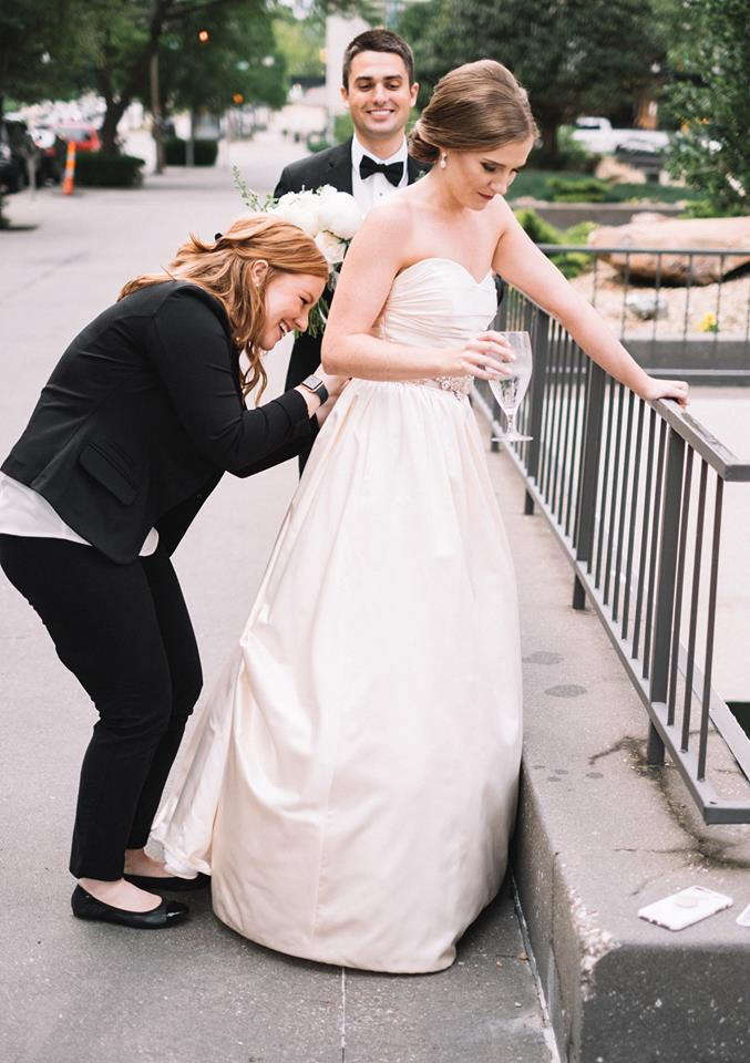 Mackenzie Praytor acting as wedding planner/super hero to a couple on their big day.  Photo Credit:    Josh McCullock