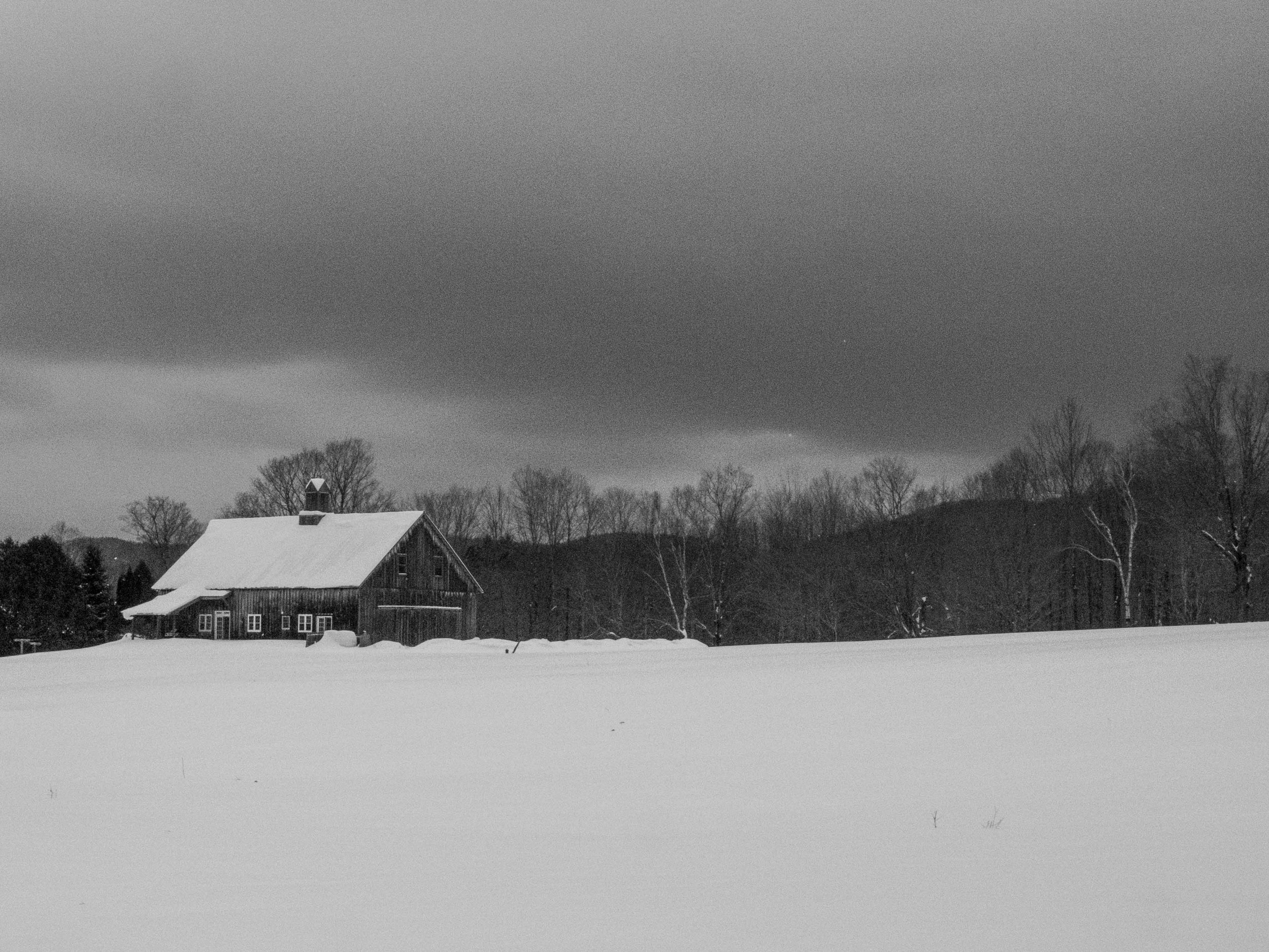 Restored barn to the west of the trail as you head south. I think it's a custom woodworking place but don't quote me.
