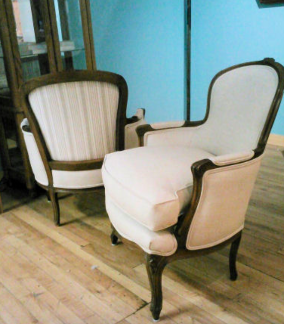This beautiful pair of chairs belonged to the client's Grandmother-in-law. After searching for something suitably small, she and her husband decided to look into reupholstery as an option. The frames were cleaned and re-glued, but we kept the original down seat cushions and selected a simple linen by Greenhouse to show off the shape of the chairs. A little striped fabric provided just a touch of fun in the back!
