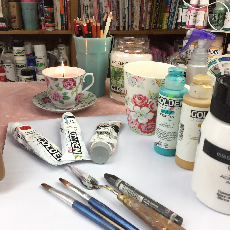 art-table-paintbrushes-paints.jpg