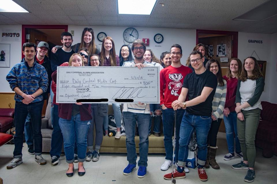 "The  Daily Cardinal  staff holds the rendering of a check made out to the paper by the DCAA in March 2018. ""A little photoshop work here, but nothing fake about how thankful our staff is for this generous check from the DCAA,""  Cardinal  editor in chief Madeline Heim  wrote  of the photo."