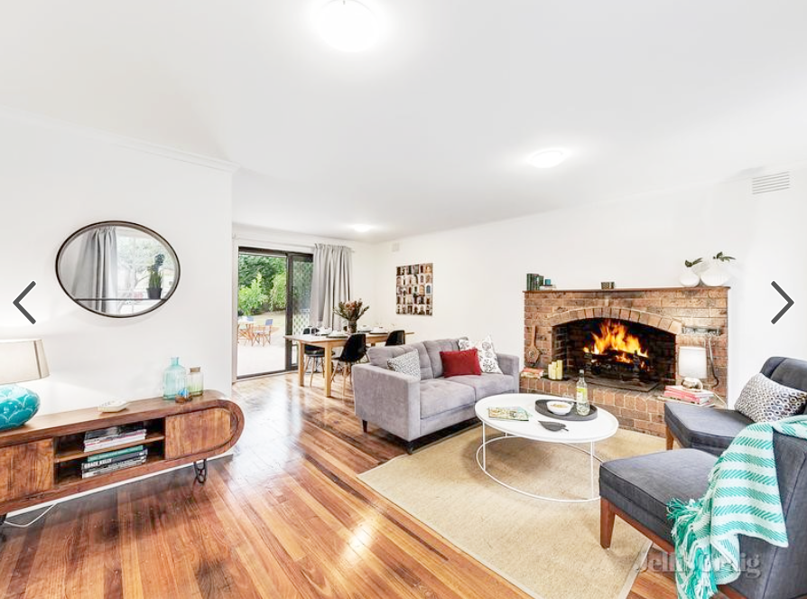 Wallpaper, carpet and window treatment removal were the first steps for this property's transformation. The preserved hardwood floors looked stunning once polished up.