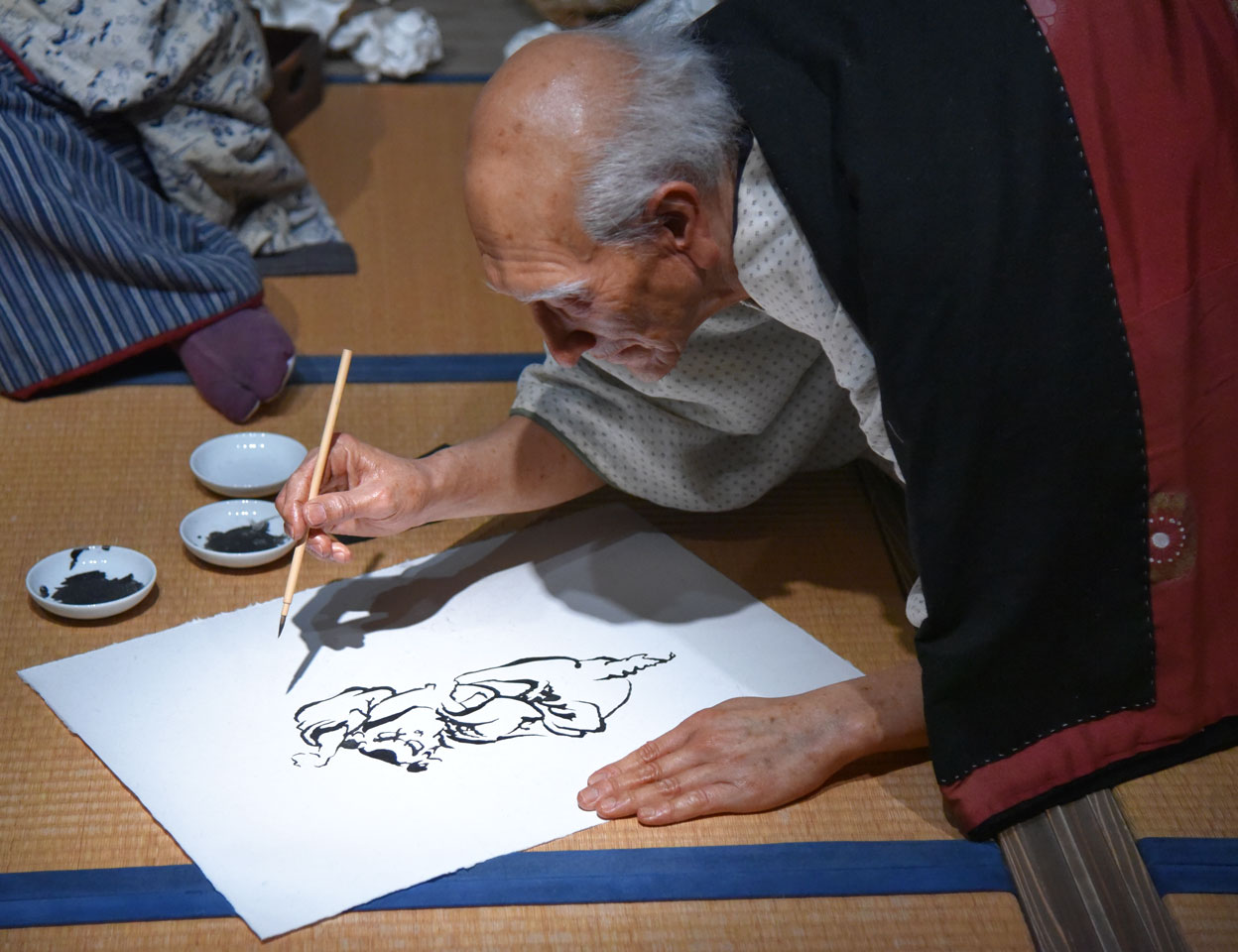 Life-size diorama of Hokusai working in his home