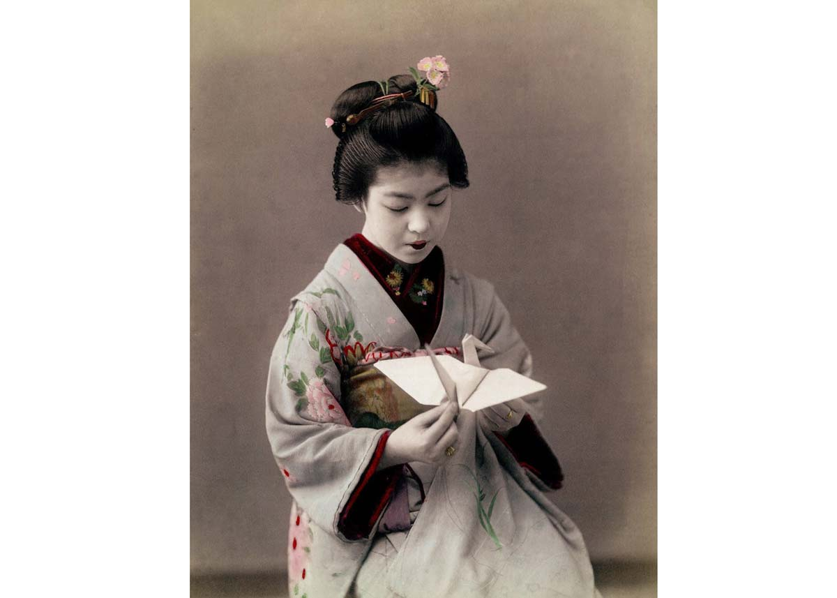 Girl Folding an Origami Crane, 1900