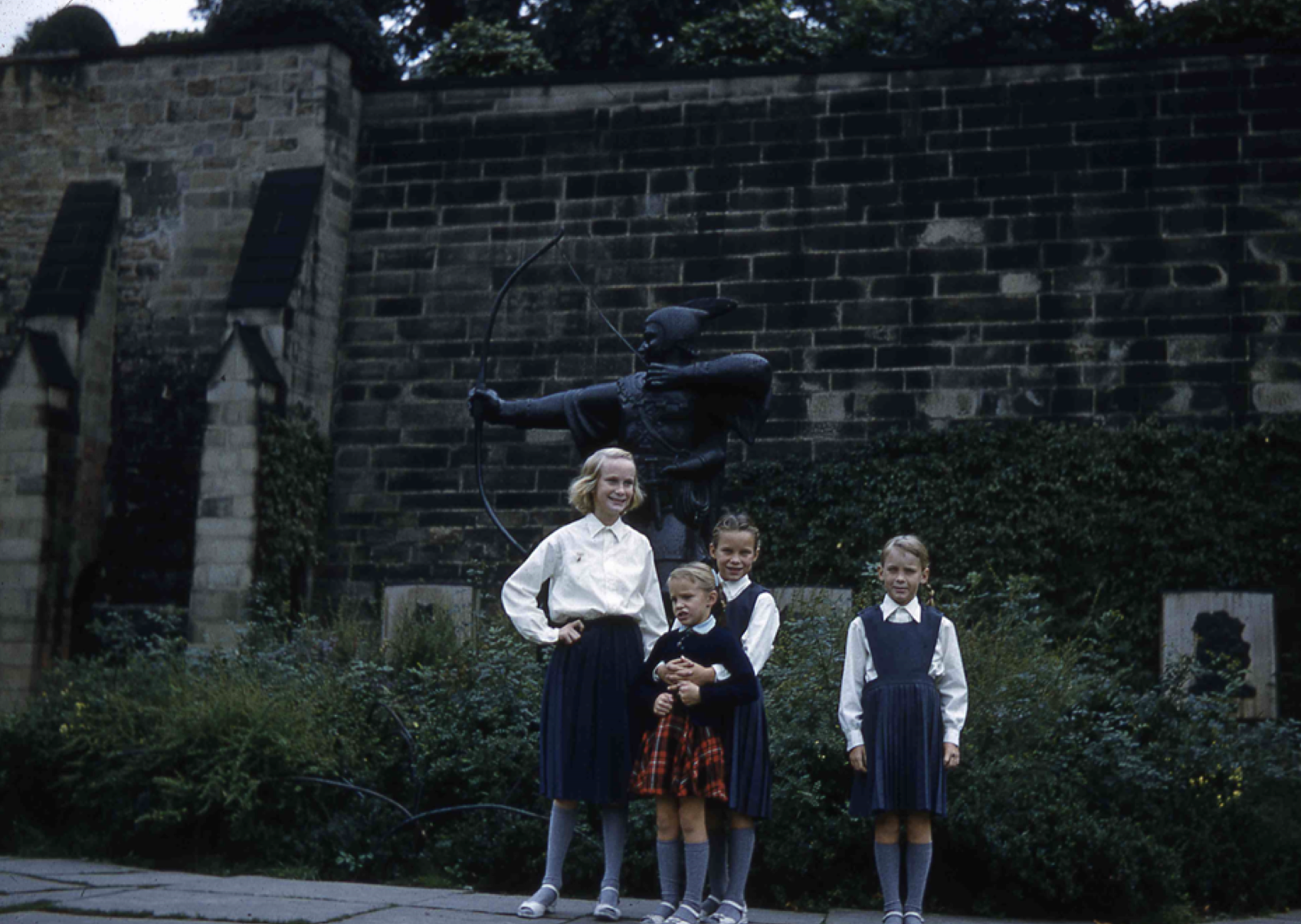 Here is a picture of us in England.  My three older sisters are in their boarding school uniforms.  Barbara is the tall one on the left. Donna and I are in the middle. Kathy is in the right.