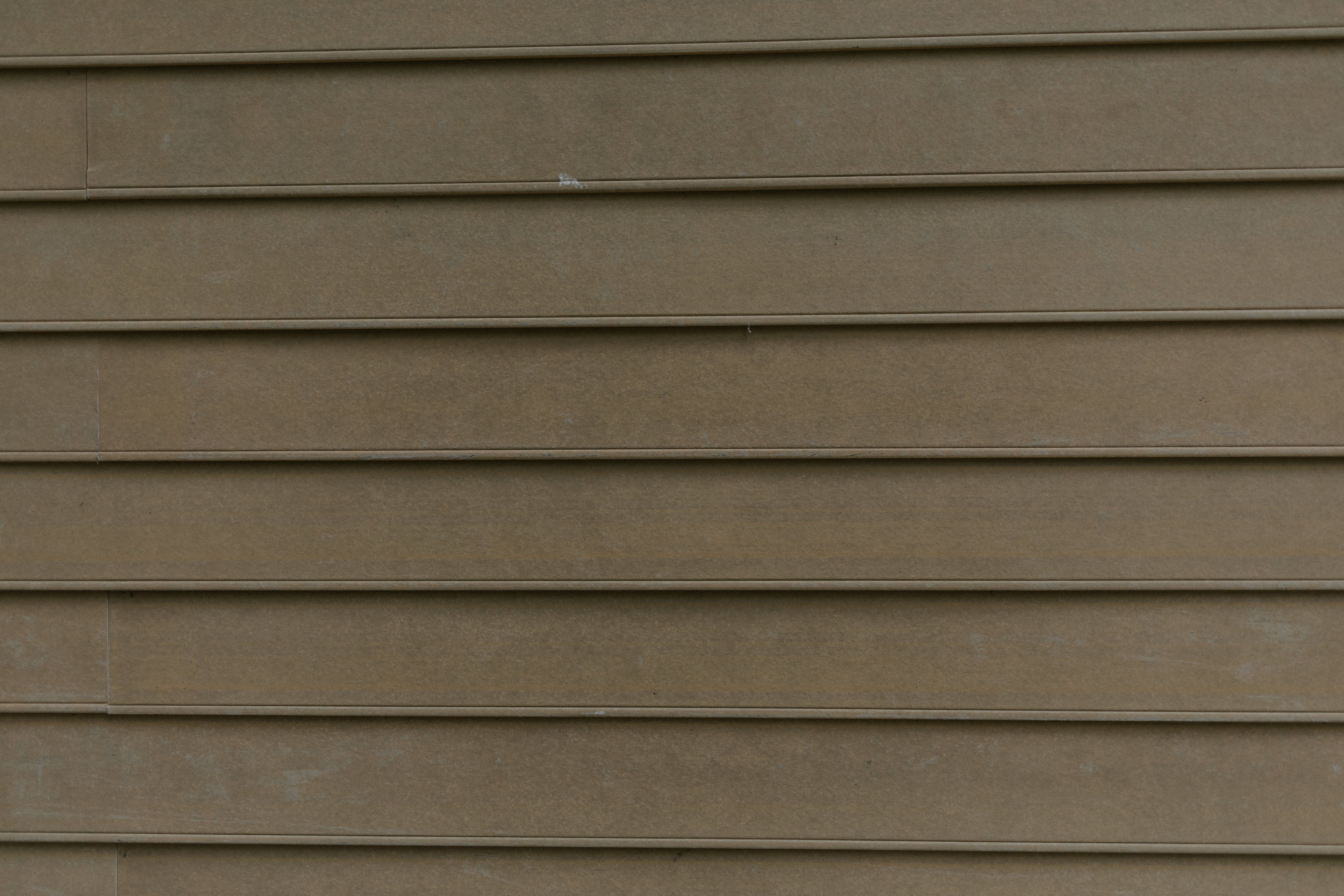 Installing James Hardie planks on an exterior wall