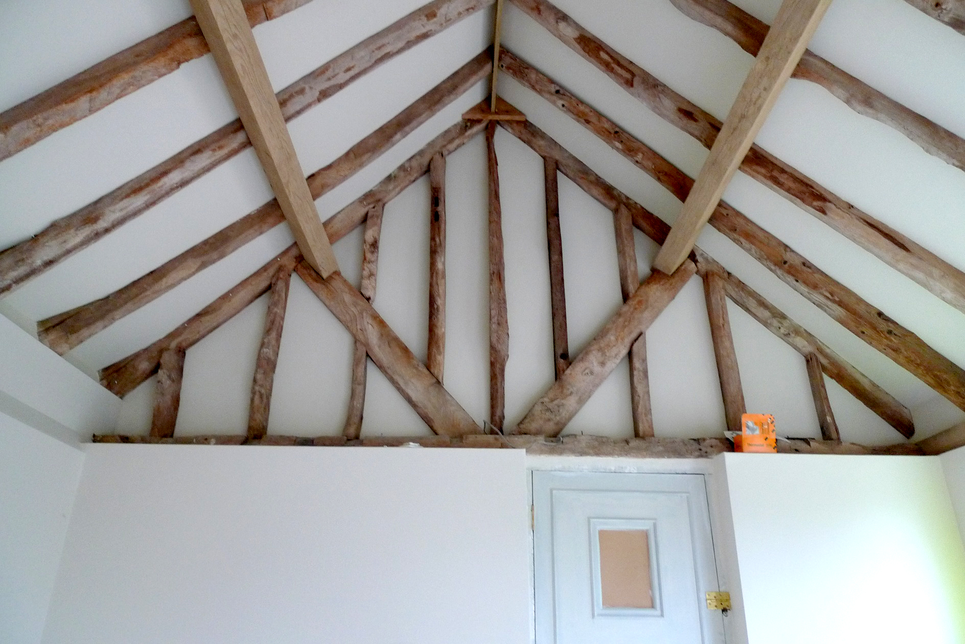 Timber trusses and frame retained