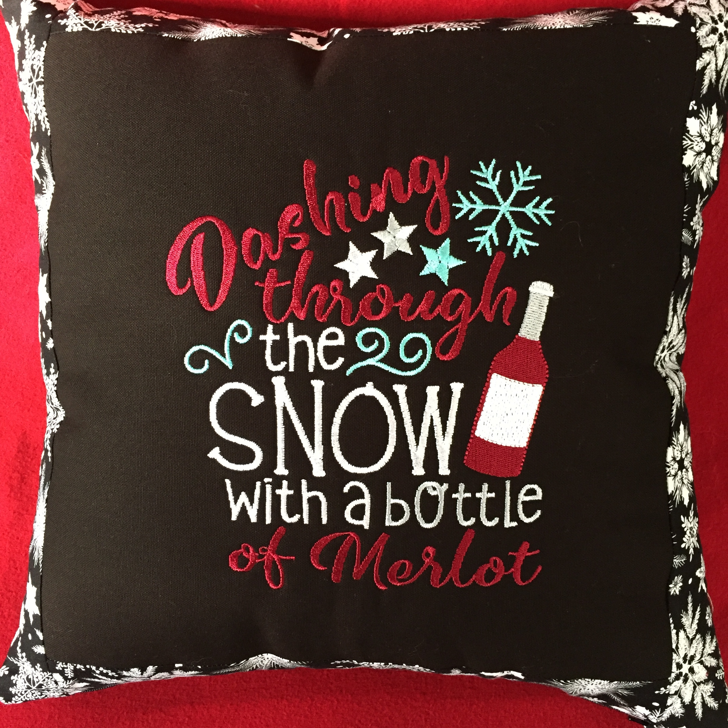embroidered holiday throw pillow from Bobbins and Needles and Threads, Oh My! ($40 vaule)