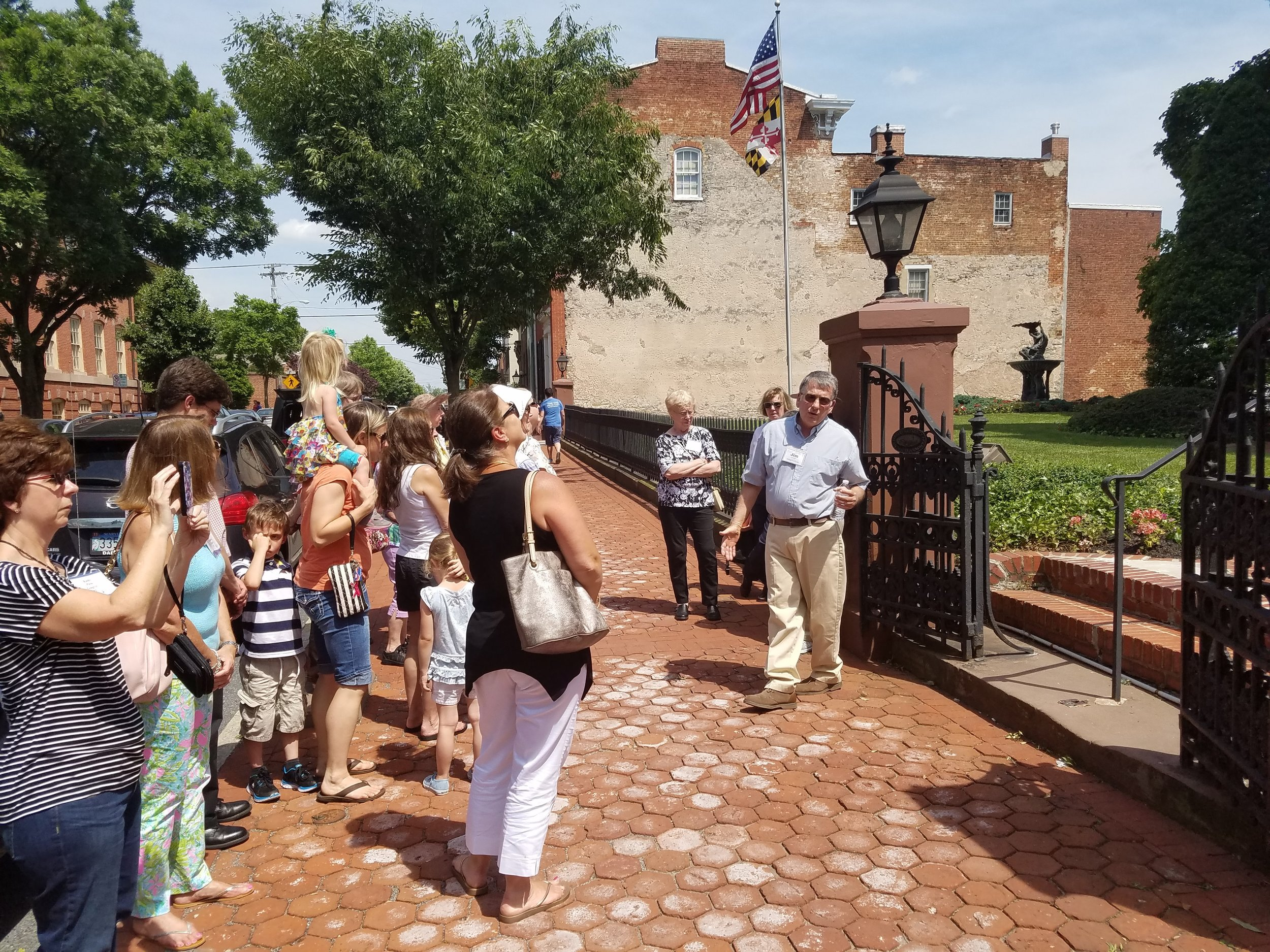 Walking Tour of Downtown Frederick, stopped in front of Keeney & Basford, the former Trail Mansion