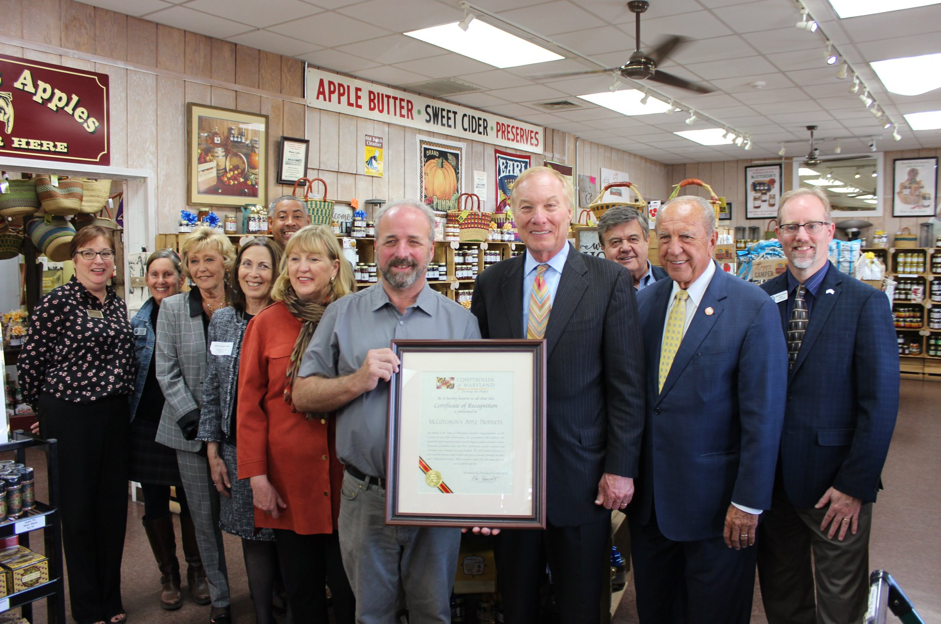 Tamar and other local representatives celebrating McCutcheon's 80th anniversary with Comptroller Peter Franchot