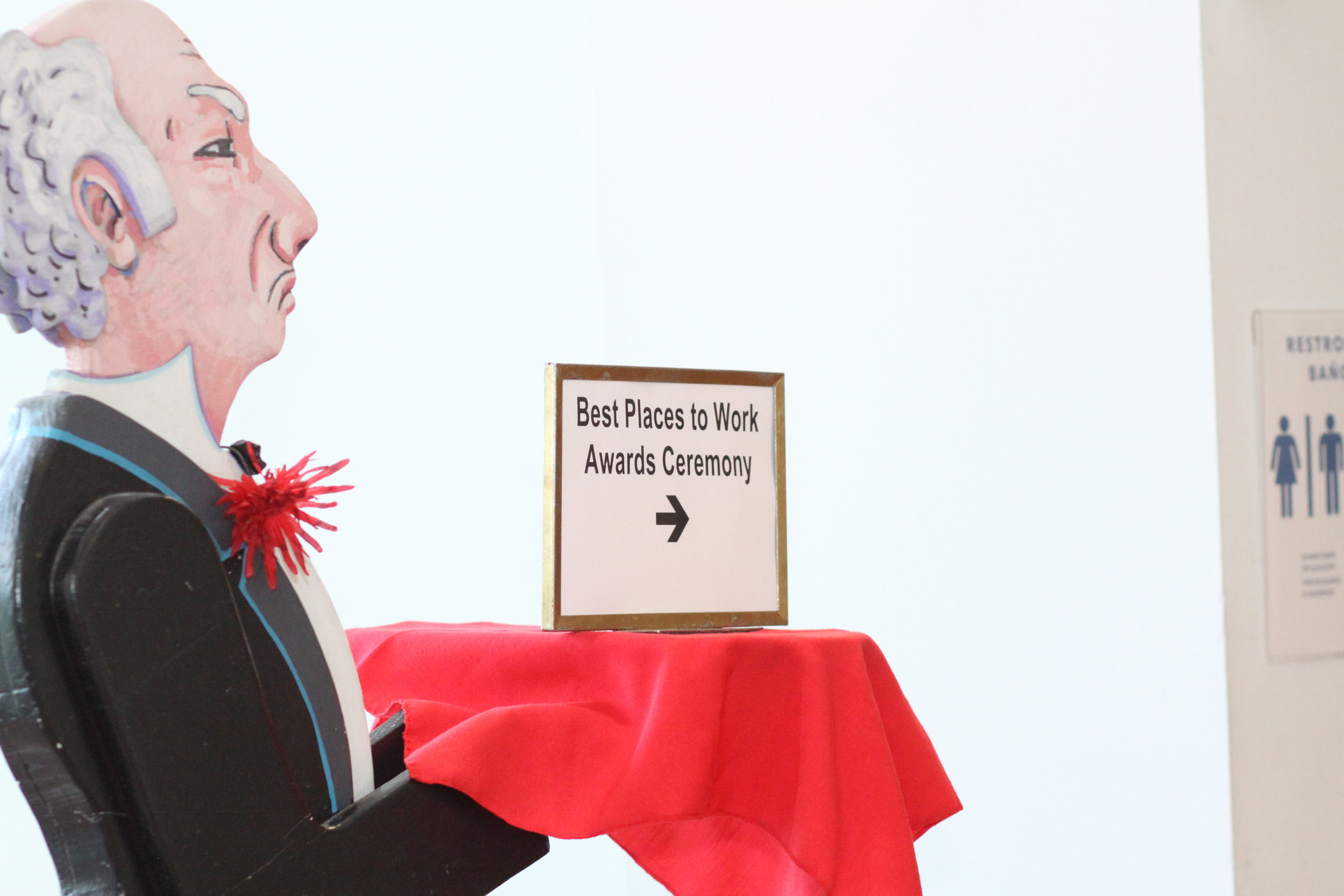 Funny butler shot with sign.jpg