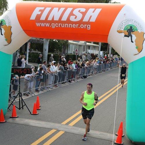 Patrick finishing the Naples Daily News Half Marathon in Naples, FL.