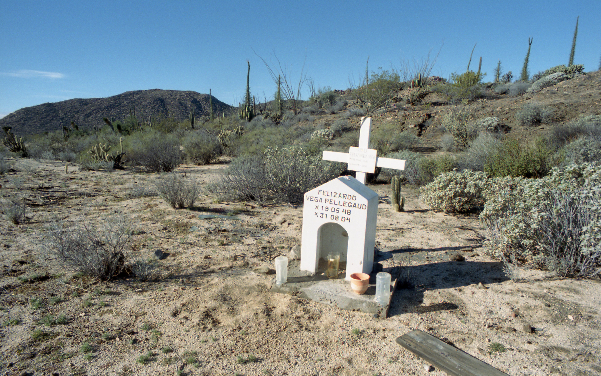 Desert Eulogy - The stretch of Highway One running down Baja Mexico is a two lane road that is fraught with twists and unmarked turns. These photos are but some of the many memorials that line its sides
