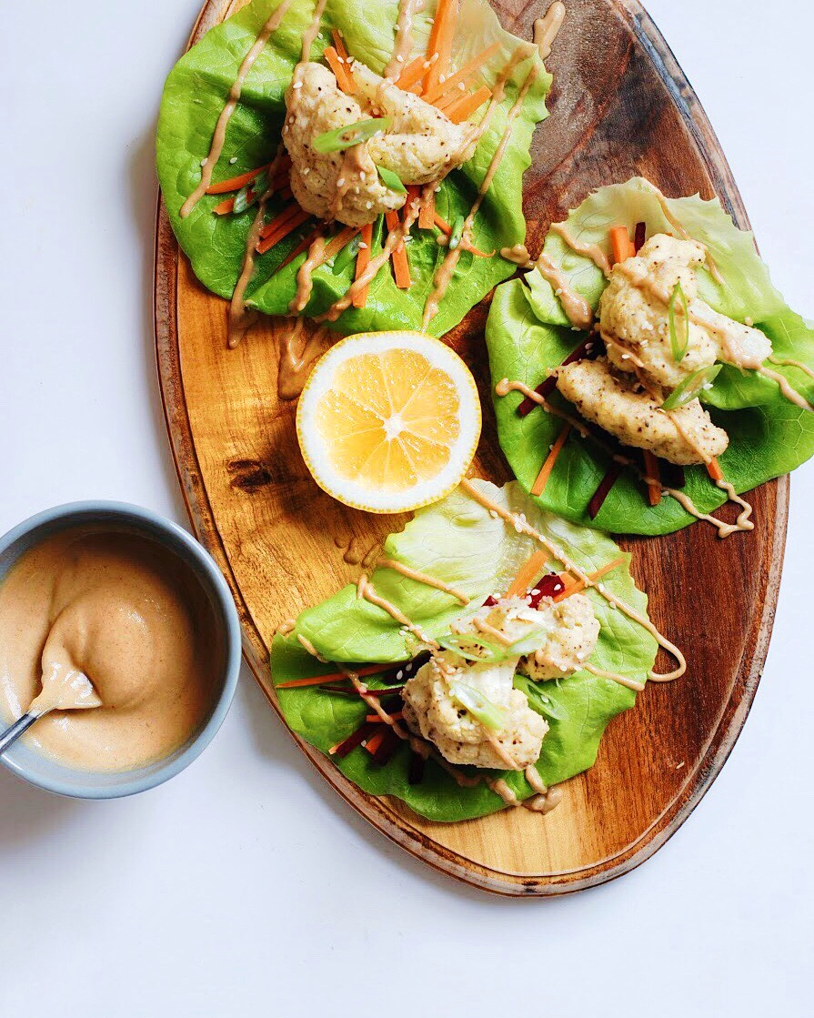 Roasted Cauliflower Lettuce Wraps with Creamy Asian Sauce. A perfect spring recipe with a dairy free sauce SO good I wish I could put it on all the things - Foody First - Paleo, Whole30, Vegetarian, Gluten Free - #paleo #whole30recipes #glutenfree #dairyfree #cauliflower #lettucetacos #healthy #healthyrecipes