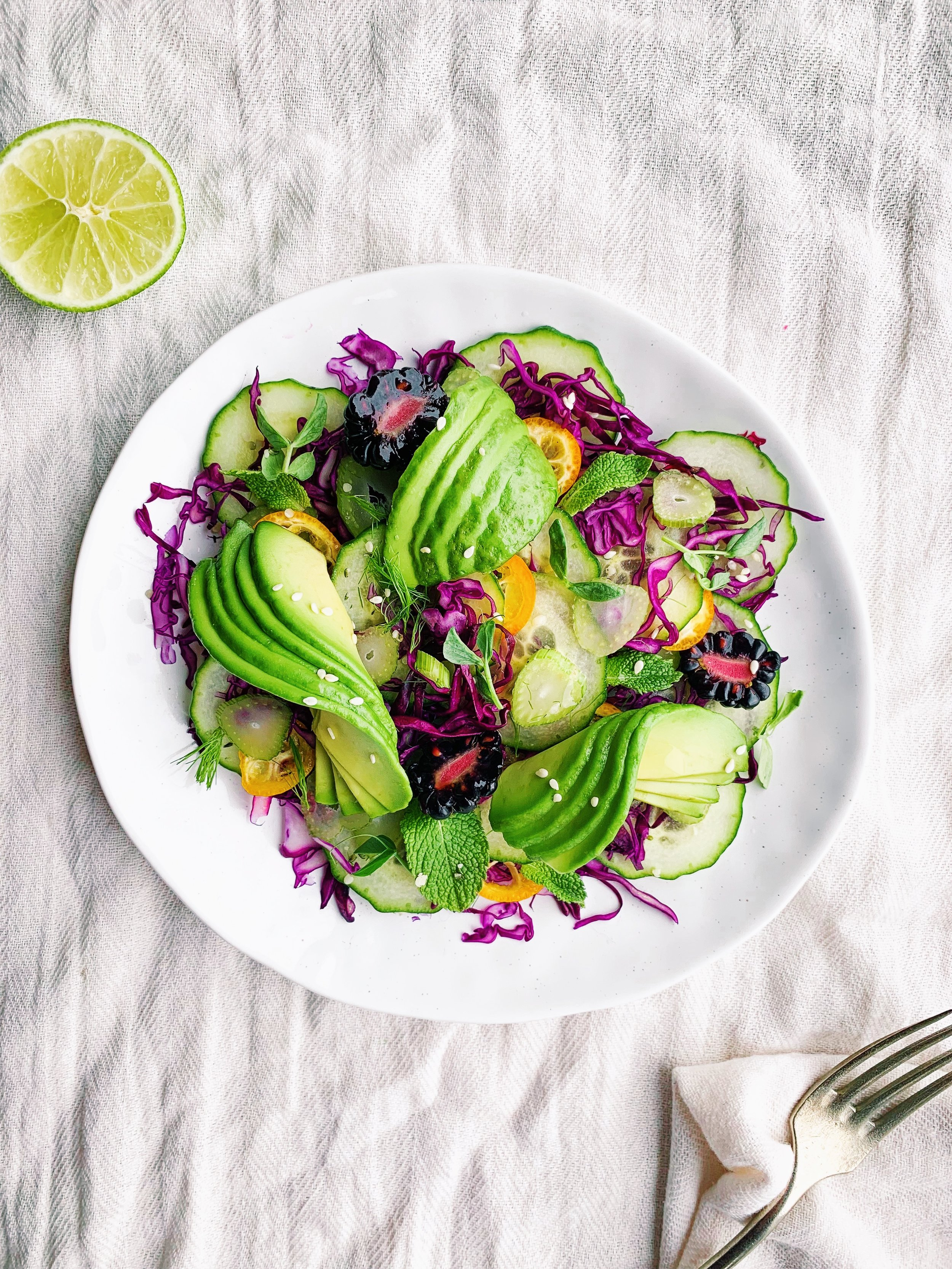 Cabbage, Fennel and Avocado Salad with Citrus and Lime - A seasonal salad when you're craving raw veggies, but you still want to enjoy all that this season has to offer! Foody First Beth Bierema #avocado #salad #whole30 #fennel #paleo #raw #vegan #plantbased #glutenfree #dairyfree