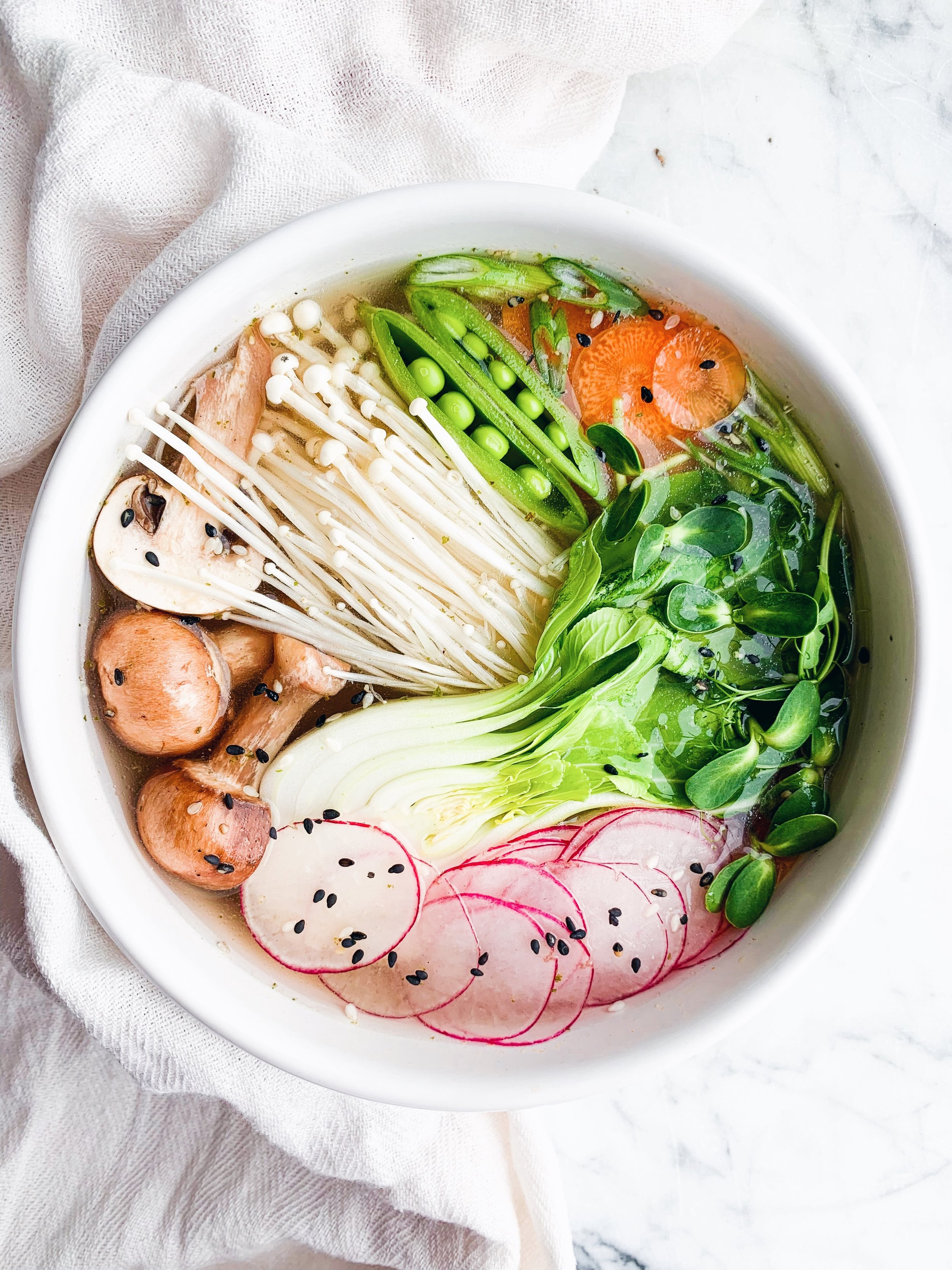"""Vegan Pho with Enoki Mushrooms and Bok Choy - an easy, vegetable packed soup that will warm you up from the inside out. The enoki mushrooms are awesome """"noodles"""" - foody first - #vegan #plantbased #glutenfree #plaeo #soup #pho #soupseason #healthy #whole30recipes #whole30"""